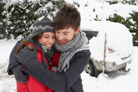19 year old: Young couple in snow with car