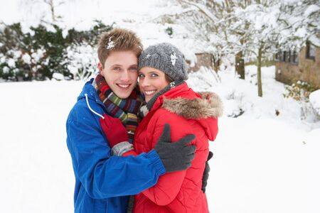 warmly: Young couple in snow