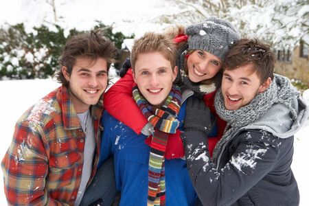 Group of young adults in snow photo