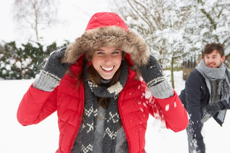 snowball: Young couple having snowball fight