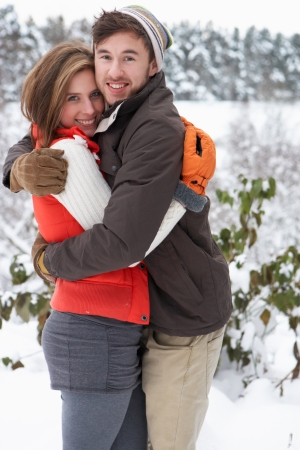 Young couple in snow Stock Photo - 11246684