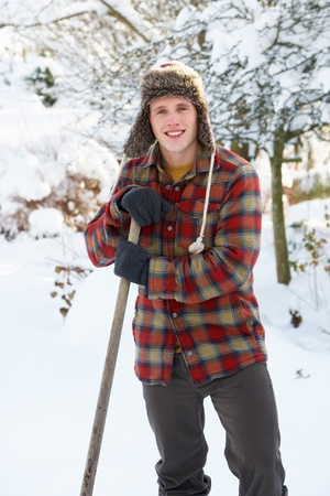 Young man clearing snow photo