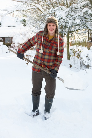 clearing: Young man clearing snow Stock Photo