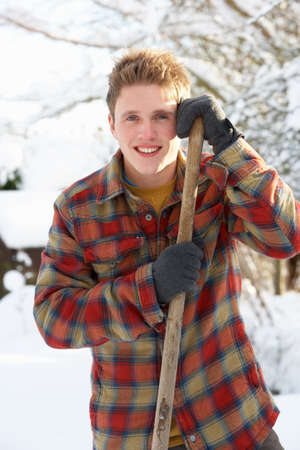 snow clearing: Young man clearing snow Stock Photo