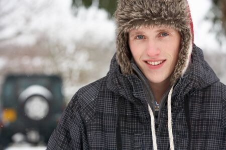 Young man in snow photo
