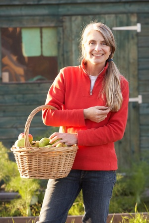 Woman with home-grown fruit photo