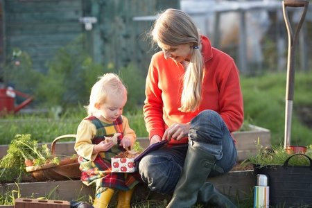 Woman and child with picnic on allotment photo