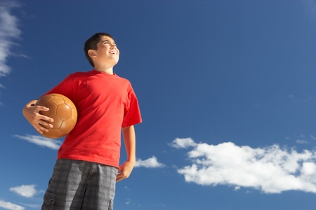 13 year old boy: Teenage boy holding football