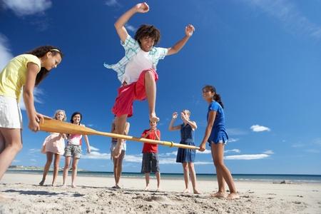 playing in the sea: Teenagers having fun on beach
