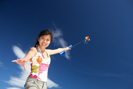 Teenage girl flying a kite photo