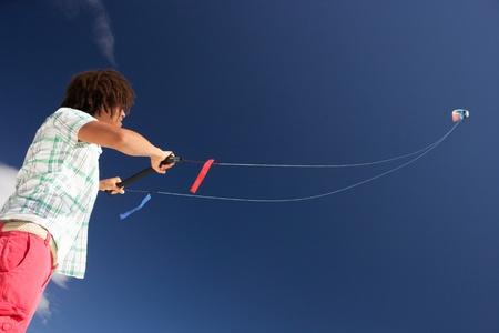 boy 16 year old: Teenage boy flying a kite