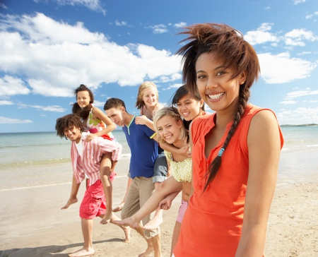 male teenager: Teenagers walking on beach
