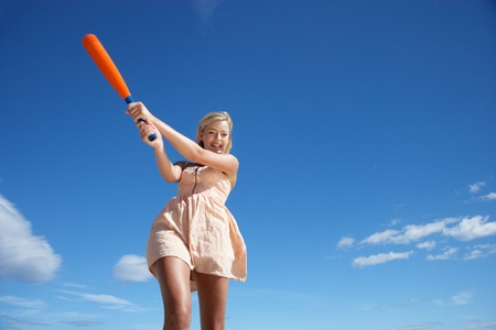 Teenage girl playing baseball Stock Photo