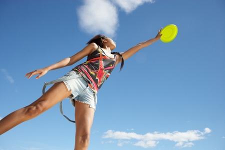 Teenage girl with frisbee photo