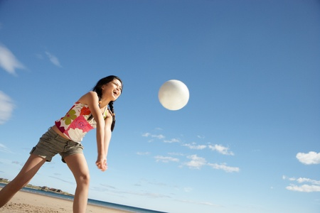 enjoy space: Teenage girl playing beach volleyball
