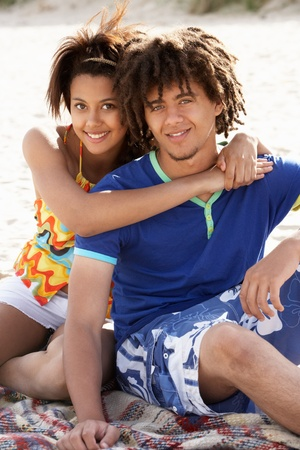 Portrait teenage couple on beach photo