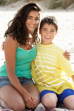 13 year old boy: Portrait teenage brother and sister on beach Stock Photo