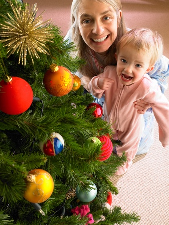 Mother and daughter with Christmas tree Stock Photo - 11246963