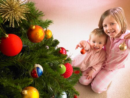 decorating christmas tree: Children with Christmas tree