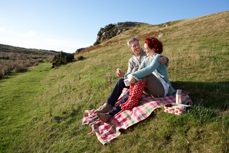 Couple on country picnic photo