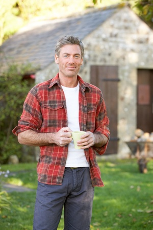 rugged: Man in country garden Stock Photo