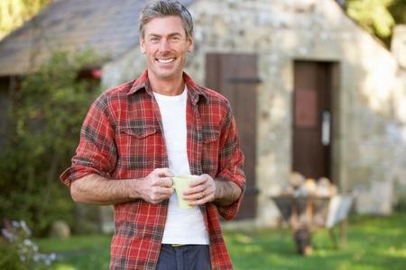 Man in country garden Stock Photo - 11246662