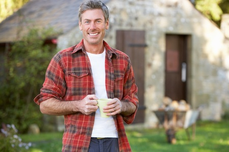 shed: Man in country garden Stock Photo