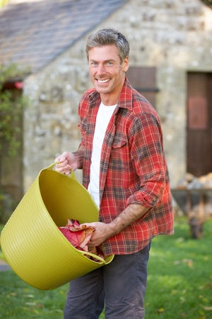 rugged: Man working in country garden Stock Photo
