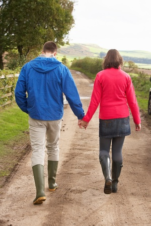 wellies: Couple on country walk Stock Photo