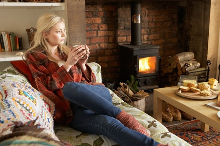 19 year old: Young woman relaxing by fire