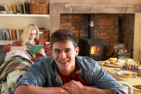 Young couple relaxing by fire Stock Photo - 11246672
