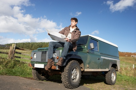 4x4: Young man in countryside with SUV