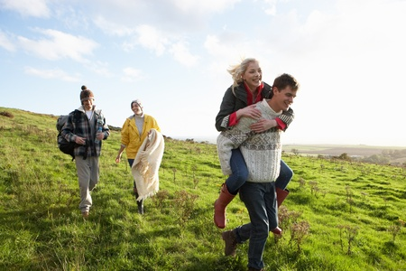 late teens: Young couples on country walk