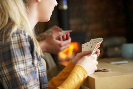 Young people playing cards photo