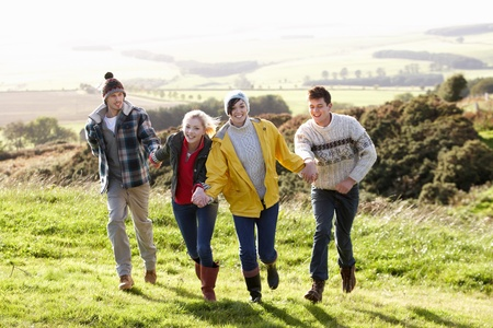 Young couples on country walk photo
