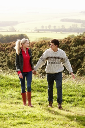 late teens: Young couple on country walk