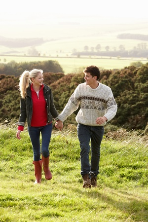 Young couple on country walk photo