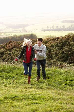 staycation: Young couple on country walk