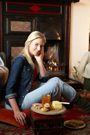 making a fire: Young woman making toast on open fire Stock Photo