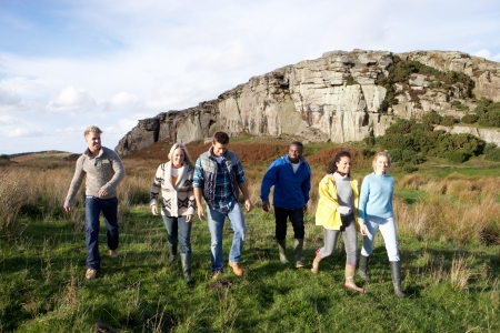 teenage girl happy: Young adults on country walk