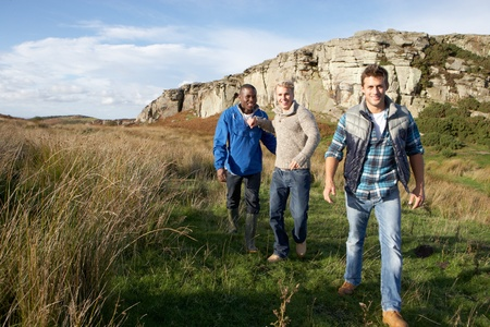 Young men on country walk photo