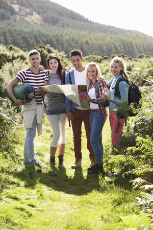 Group Of Young People On Camping Trip In Countryside photo