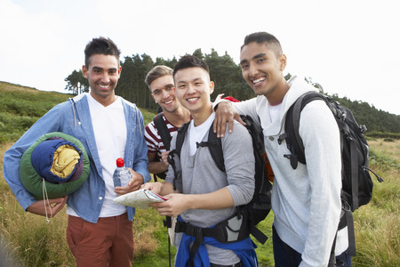 Group Of Young Men On Camping Trip In Countryside photo