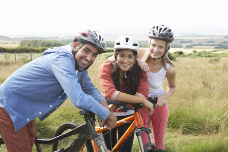 mixed race people: Group Of Young People Cycling In Countryside