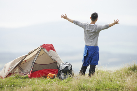 Young Man On Camping Trip In Countryside photo