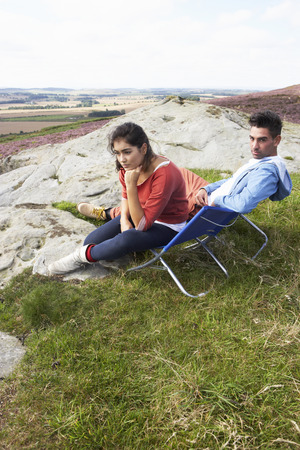 16 year old girls: Young Couple Sitting In Chairs On Camping Trip