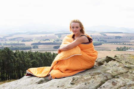 sleeping bag: Teenage Girl In Sleeping Bags Admiring View Stock Photo