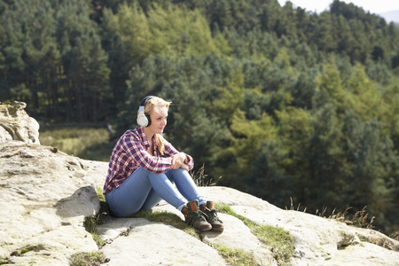 17 year old: Teenage Girl Listening To Music In Countryside