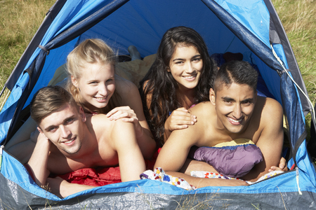 boy 16 year old: Young Couples On Camping Trip In Countryside Stock Photo
