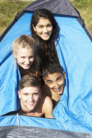 19 year old boy: Young Couples On Camping Trip In Countryside Stock Photo